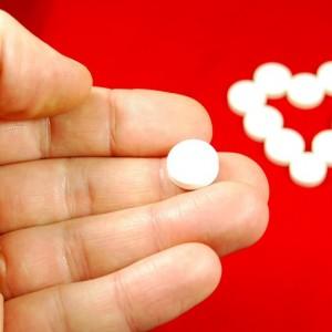Hand holding pills for heart diseases